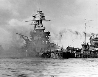 Hoga (YT-146) - Hoga pushes the sinking USS Nevada to safety in soft sand after the attack on Pearl Harbor.