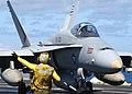 US Navy 030124-N-9563N-506 Flight deck personnel direct an F-A-18 Hornet after landing.jpg