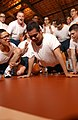 US Navy 030510-N-5862D-467 Seaman Recruit Miguel Ortega, from East Los Angeles, Calif. completes 152 push-ups in two minutes during the Captains Cup athletic competition as members of his division cheer him on.jpg