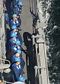 US Navy 030612-N-4374S-010 Sailors aboard the Aegis class, guided missile cruiser USS Vella Gulf (CG 72) heave on a stanchion line to receive the fuel line during the underway replenishment with the German oiler FGS Rhoen (A 1.jpg