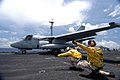 US Navy 040609-N-4190W-001 Two flight deck shooters aboard USS John F. Kennedy (CV 67), signals the launch off an S-3 Viking.jpg