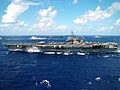 US Navy 040807-N-0120R-115 Aircraft carriers USS Kitty Hawk (CV 63) and USS John C. Stennis (CVN 74) steam into position for a photo exercise.jpg