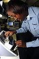 US Navy 041007-N-8158F-018 Disbursing Clerk 3rd Class Lakisha Williams of Memphis, Tenn., completes cash verification using the Magner 75 cash counting machine aboard the aircraft carrier USS Nimitz (CVN 68).jpg