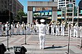 US Navy 050804-N-9293K-003 Lt.j.g. Chuck Roegiers directs the Navy Northwest Band in a rendition of Yankee Doodle at the Westlake Plaza for the 55th annual Seafair Festival.jpg