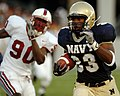 US Navy 050910-N-9693M-005 U.S. Naval Academy Midshipmen slotback Karlos Whittacker outpaces Stanford Cardinal linebacker Udeme Udofia to score in the 2nd quarter.jpg