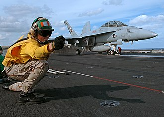 Personnel of the United States Navy - Image: US Navy 051120 N 0119G 001 U.S. Navy Lt. Sean Mc Carthy, a Shooter, gives the signal to launch an F A 18F Super Hornet
