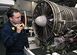 aviation machinists mate 3rd class ad3 moreao salinas inspecting a jet engine for foreign object damage in the jet shop onboard uss george washington