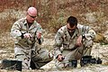 US Navy 061027-N-4515N-395 Explosive Ordnance Technician 1st Class Shane Mann and Chief Explosive Ordnance Technician Tim Spiak assigned to Explosive Ordnance Disposal Mobile Unit Two (EODMU-2), assembles an explosive charge.jpg