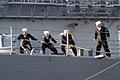 US Navy 061114-N-1713L-030 Sailors on board the guided-missile frigate USS Nicholas (FFG 47) heave a mooring line to secure the ship after arriving into their homeport at Naval Station Norfolk.jpg