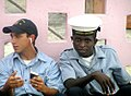 US Navy 070308-N-6783N-017 Seaman Apprentice Dustin Eckhart shares a friendly moment with a coast guardsman from São Tomé and Príncipe.jpg