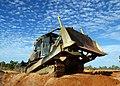 US Navy 070604-F-8678B-041 Equipment Operator 3rd Class Angel Garcia Jr., Naval Mobile Construction Battalion (NMCB) 4, operates a bulldozer.jpg