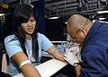 US Navy 070621-N-4954I-070 Air Force Tech Sgt. Richard Rubi draws blood from a Filipino patient aboard USS Peleliu (LHA 5).jpg