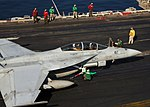US Navy 070930-N-8463W-047 Flight deck personnel perform a pre-launch check on a F-A-18F Super Hornet.jpg