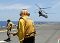 US Navy 090414-N-9950J-155 Aviation Boatswain's Mate (Handling) 3rd Class Apolinar Garcia, left, and Aviation Boatswain's Mate (Handling) 1st Class Keith Heatherly direct CH-46E Sea Knight helicopters.jpg