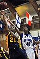 US Navy 090514-N-8726C-002 All-Navy Basketball Team member, Yeoman 3rd class Syreeta Bromfield-Kemp, assigned to U.S. Coast Guard Training Center, Cape May, N.J., scores two points during a basketball game against the Air Force.jpg
