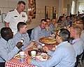 US Navy 090515-N-8848T-300 Rear Adm. Robert D. Reilly, Jr., commander of Military Sealift Command, speaks with recruits during a Pizza Night at Recruit Training Command.jpg