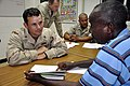 US Navy 090602-N-4928M-026 Builder 1st Class Joseph Sage, assigned to Maritime Civil Affairs Team 104, conducts English lessons with Sergeant Houssein Walieh from the Djiboutian Police force.jpg