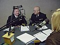 US Navy 091002-N-2888Q-002 Lt. Cmdr. Damon Slutz, commanding officer of Navy Operation Support Center Albuquerque, left, and Lt. Kris Hooper, assigned to the Navy Office of Community Outreach, conduct a radio interview with Amy.jpg