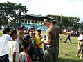 US Navy 091029-F-8858G-083 A Navy Special Warfare Sailor assigned to Joint Special Operations Task Force Philippines coaches children at the first children's day event at the Armed Forces of the Philippines.jpg