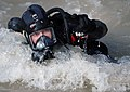 US Navy 091127-N-4154B-086 Navy Diver 2nd Class Zachery Dojaquez comes to the surface of the water during a dive.jpg