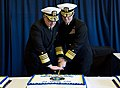 US Navy 100126-N-3705H-062 Commanders cut a cake commemorating the command's establishment during a ceremony at Joint Expeditionary Base Little Creek Fort Story.jpg