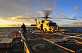 US Navy 100310-N-4774B-008 Aboard the guided-missile cruiser USS Bunker Hill (CG 52), an aircrew member exits an SH-60F Sea Hawk helicopter.jpg