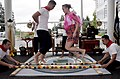 US Navy 100527-N-2304O-074 Sailors perform the Tinikling, the national dance of the Philippines, at the Asian Pacific Heritage Month celebration on the quarterdeck at Naval Hospital Bremerton (NHB).jpg