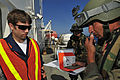 US Navy 100527-N-7364R-131 A Spanish navy visit, board, search and seizure team member verifies identification of a crewmember aboard the Military Sealift Command container and roll-on-roll-off ship USNS LCPL Roy M. Wheat (T-AK.jpg