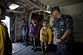 US Navy 100701-N-5319A-036 Capt. Peter Brennan jokes with Aviation Boatswain's Mate 3rd Class Kelley Soucy.jpg