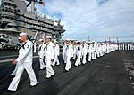 US Navy 100725-N-6233H-024 Sailors prepare to man the rails as the aircraft carrier USS George Washington (CVN 73) departs Busan, Republic of Korea.jpg