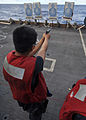 US Navy 100914-N-2013O-038 nterior Communications Electrician 3rd Class Kyle Adona, from Vallejo, Calif., fires an M-9 pistol during a small-arms l.jpg