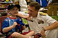 US Navy 110829-N-YM440-172 Vice Adm. Dirk Debbink, Chief of Navy Reserve, visits a patient during a Caps For Kids event at Cincinnati Children's Ho.jpg