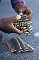 US Navy 111117-N-PB383-080 Aviation Boatswain's Mate (Fuels) Airman Ameyaw Obarima organizes ammunition during a 7.62 × 51 mm NATO live-fire exercise.jpg
