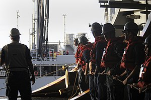 US Navy 111221-N-RG587-421 Sailors assigned to the line handling detail prepare to link the Nimitz-class aircraft carrier USS Carl Vinson (CVN 70).jpg