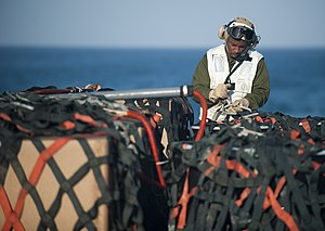US Navy 120129-N-PB383-461 Master Sgt. Joseph Kelly prepares cargo for transfer on the flight deck of the amphibious transport dock ship USS New Or.jpg