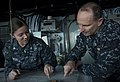 US Navy 120204-N-CS815-076 Chief of Naval Operation (CNO) Jonathan Greenert and Quartermaster 3rd class Katrina Wright look over a navigation chart.jpg