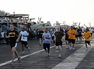 US Navy 120215-N-NB694-049 Sailors participate in a 5-kilometer fun run on the flight deck of the Nimitz-class aircraft carrier USS Abraham Lincoln.jpg