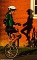 Unicyclist's Shadows (9503910379).jpg