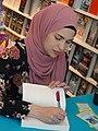 Uzma Jalaluddin signs her novel -b (48014871628).jpg