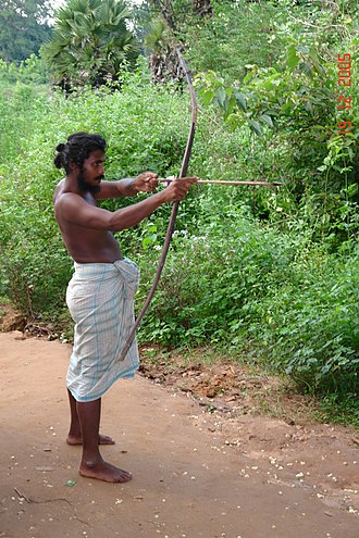 Vedda - A Veddah hunter with bow and arrow.
