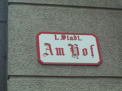1., An old street sign with abbreviated district name Innere Stadt, which is the 1st district.