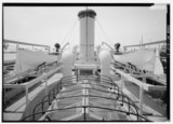 View forward from secondary bridge; note stack for venting after boilers, ventilators, davits, searchlights on port and starboard stanchions and ship's pulling boats; skylight HAER PA,51-PHILA,714-21.tif