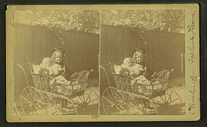 View of a child and a baby in a stroller, from...