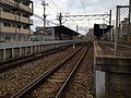 View of platform of Wajiro Station (Nishitetsu) from crossing south of Wajiro Station.JPG