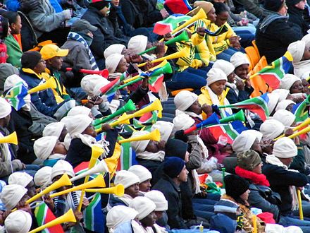 A 2010 FIFA World Cup crowd blowing vuvuzelas