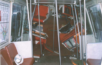 Telescoping (rail cars) - Interior of Washington Metro car 1077 following telescoping in a head-on collision.  This car sustained a loss of 34 linear feet of passenger compartment space (nearly half the car) due to telescoping.