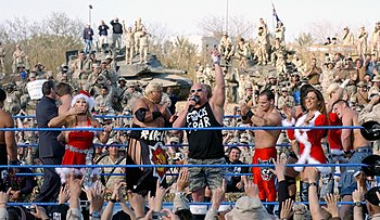 WWE superstars performing for the Coalition troops at Camp Victory