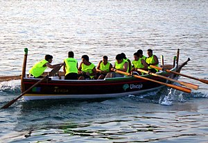 "Coastal and offshore rowing - Regatta of ""barcas de jábegas"" in the Port of Málaga, Spain."