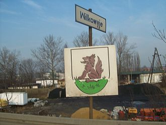 Wilkowyje - Wilkowyje Coat of Arms on a road welcome sign