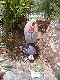 Woman Baking Bread on Saj Oven in Artas, West Bank, Palestine.JPG
